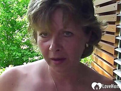 Busty MILF shows her pussy around a close-up